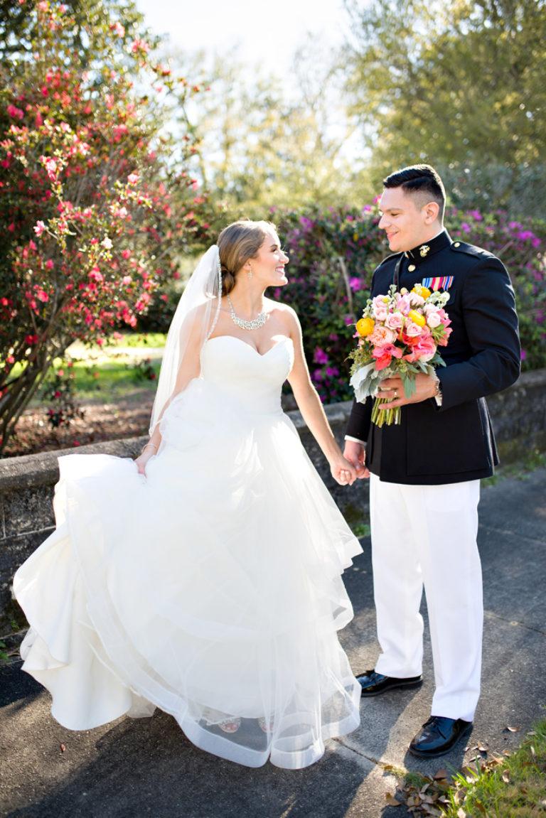 marine wedding sun flare bouquet bride and groom