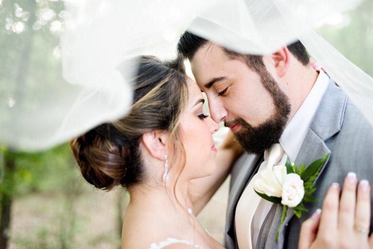 Veil shot bride and groom