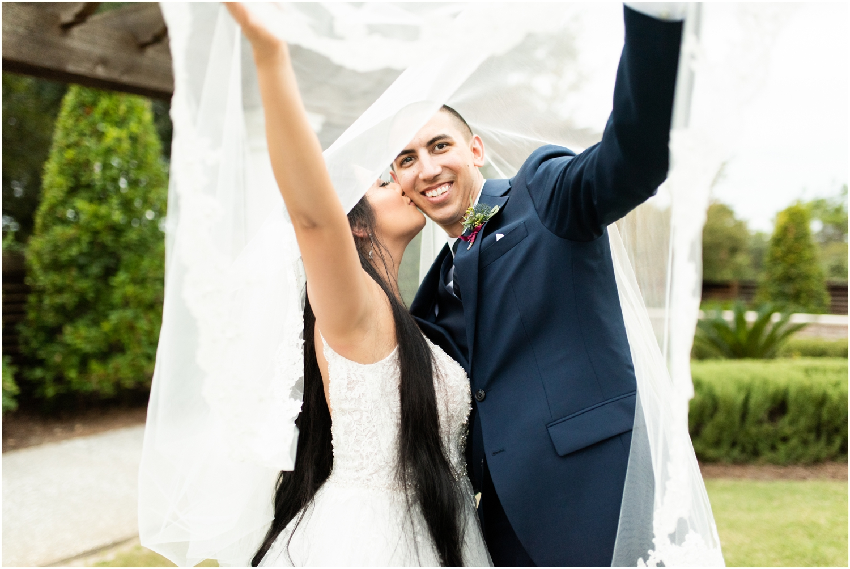 Henderson Beach Resort Inn Destin Florida Wedding Photographer Bride and Groom portrait veil shot