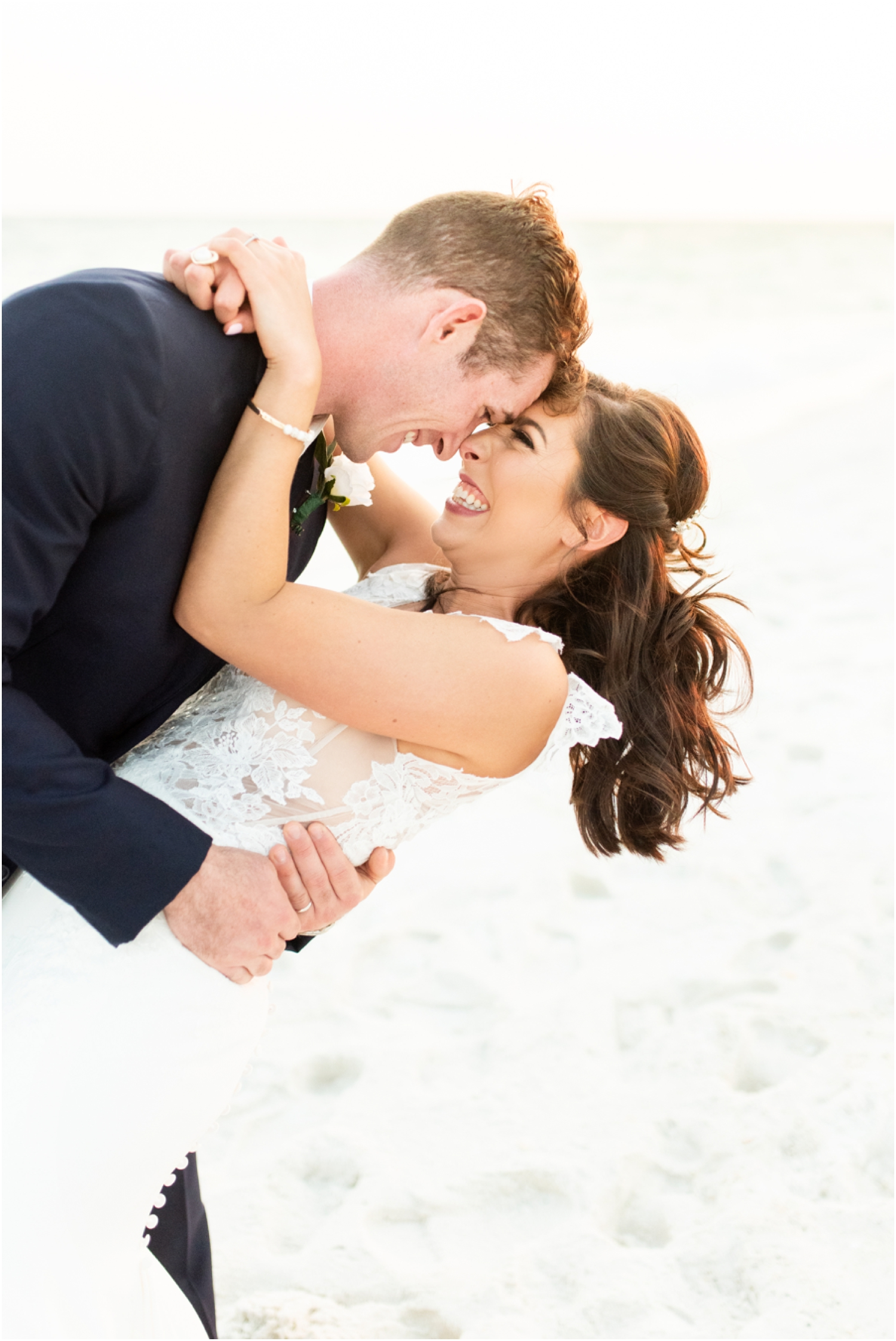 Portofino Island Resort Pensacola Beach Wedding Photographer bride groom sunset portraits dip kiss