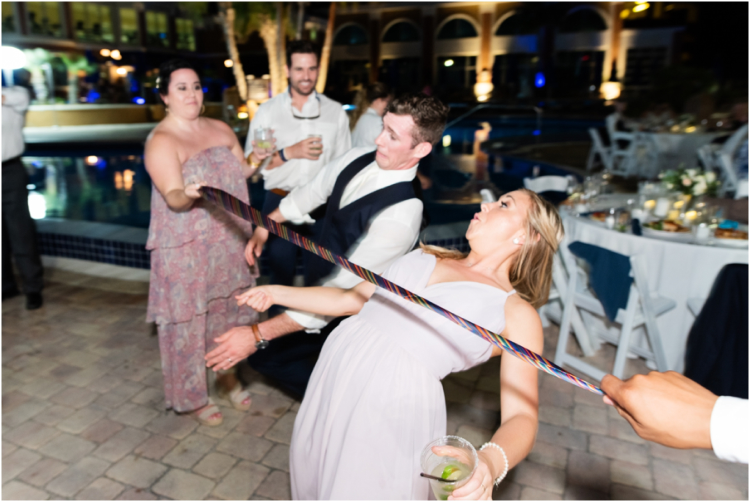 Portofino Island Resort Pensacola Beach Wedding Photographer reception dancing limbo