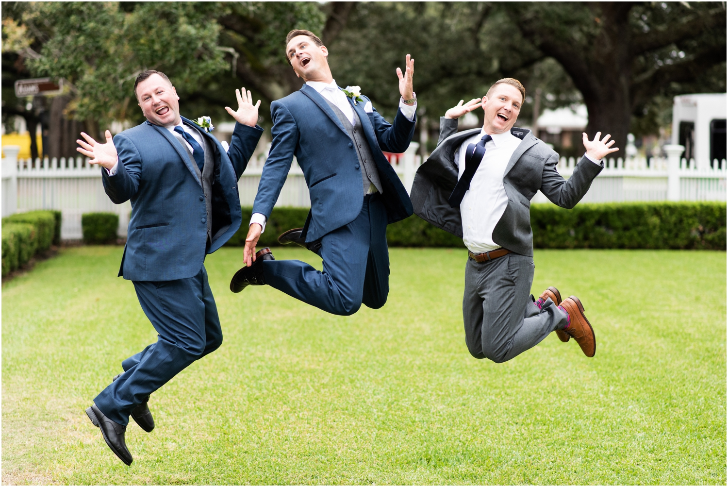 Old Christ Church Palafox Wharf Rainy Day Wedding Groomsmen Jump Shot
